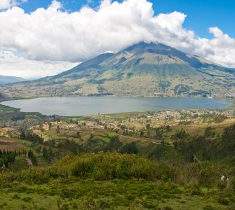 The shrouded mountain environment of Tayta Imbabura contrasts with the calm waters of Imbakucha (formerly San Pablo Lake) amidst the cultural landscape of the Utawallu runakuna ethnic group of the Kichwa nation of northern Ecuador. Photo: César Cotacachi