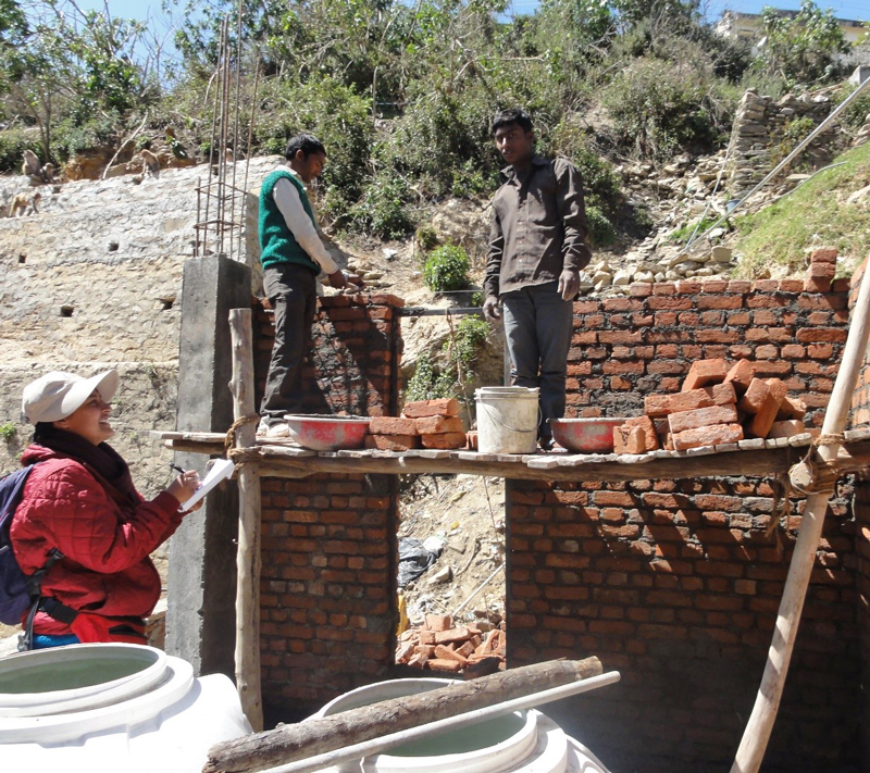 Researcher Neelakshi Joshi interviews masons as they construct a house in Almora, India. Photo by Neelakshi Joshi